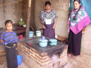 Juana Ernandez-Gomez of Foro posing with two Modified Justa Stove beneficiaries in Jech Entik Village, Chiapas. Photo courtesy of Tirian Mink, June 2010