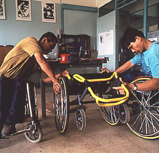 Inspecting a finished wheelchair.jpg