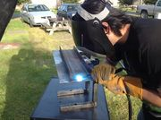 Welding iron plate to c bracket.jpg